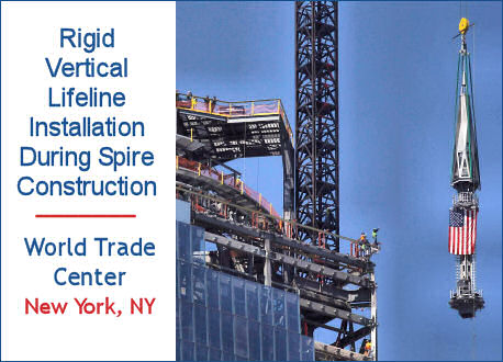 Vertical rigid fixed-track lifelines installation during spire construction, World Trade Center, New York.