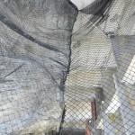 Combined Personnel and Debris Containment Netting With Inlaid Mesh Liner