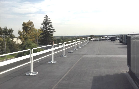 Installation of Non-Penetrating Guardrails With Flat Roof Perimeter Edge Protection