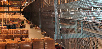 Debris Containment Netting in Distribution Warehouse