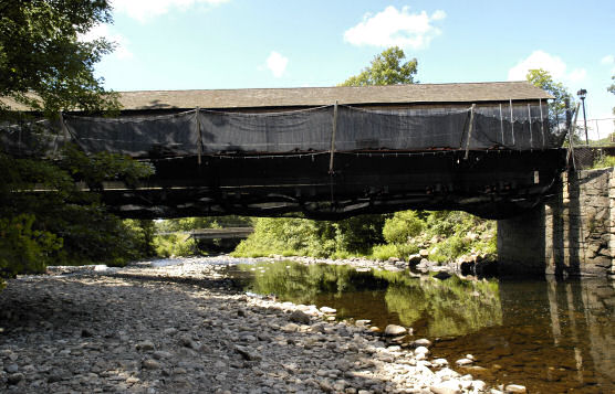 Fine Mesh Debris Nets Used During Historic Covered Bridge Rehabilitation