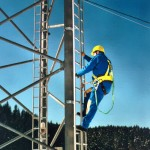 Rigid fixed track and vertical lifeline installation as personal fall arrest system.
