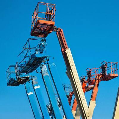 Self-retracting lifeline anchored to basket on boom lift.