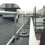 Custom engineered modular rooftop railings on multi-level roof for Fortune 500 defense contractor.