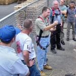 Demonstration of proper use of horizontal cable lifelines.