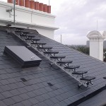 Kee Walk non-slip OSHA-compliant non-penetrating roof walkway installations for safe rooftop access.