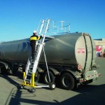 Portable ladder access system for a tanker truck, loading dock, flatbed truck, bus, or railcar.