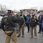 Demonstration of the proper use of fall protection body harness.